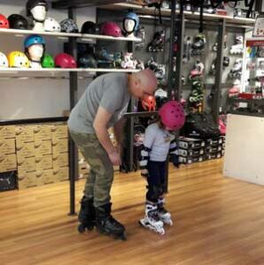 little girl learning inline skates